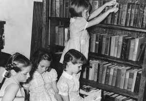Old photo of young children at library